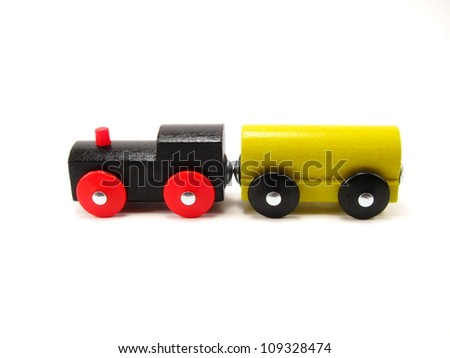 Two Wooden Toy Trains Facing Left