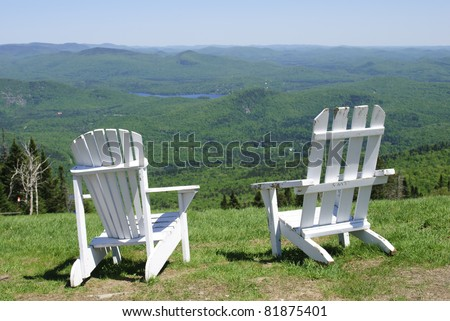 Two wooden white deck chairs in Mont Tremblant Parc