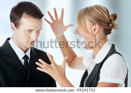 Two work colleagues arguing (male and female)