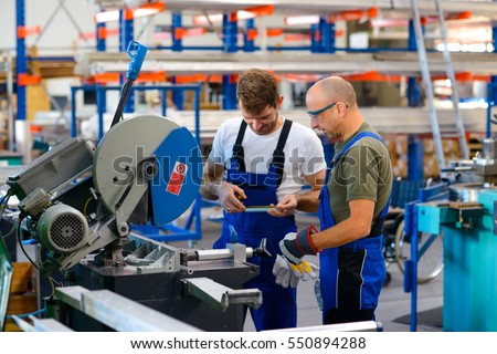 two worker in factory on the...