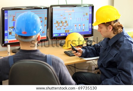 Two Workers in Control Room