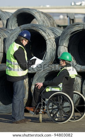 Two workers inspecting at cable wire construction site