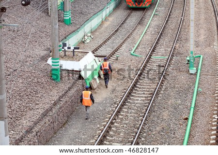 two workpeople on railway at day