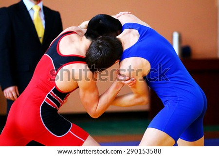 Two wrestlers Greco-Roman wrestling during  competition