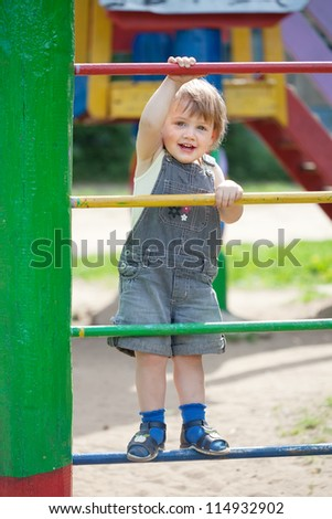 two-year child at playground area in summer