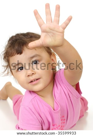 Two-year-old hispanic girl making a high-five sign, isolated on white background