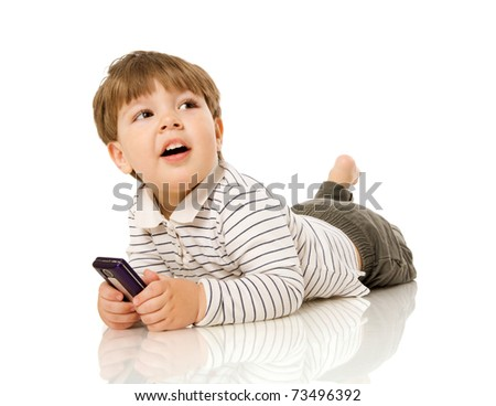 Two years boy smiling sitting on floor isolated on white