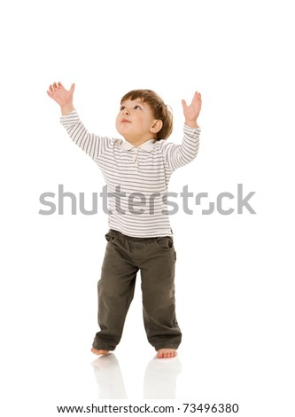 Two years boy standing pointing up isolated on white - stock photo