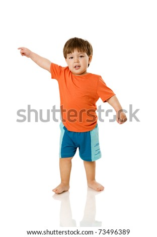 Two years boy standing pointing up isolated on white