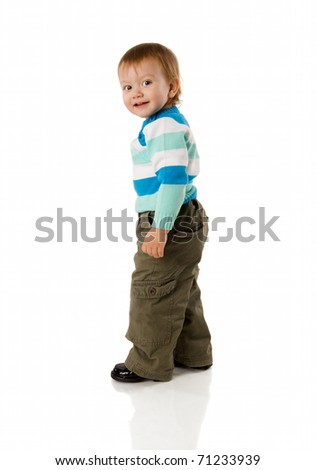 Two years boy standing turning back isolated on white