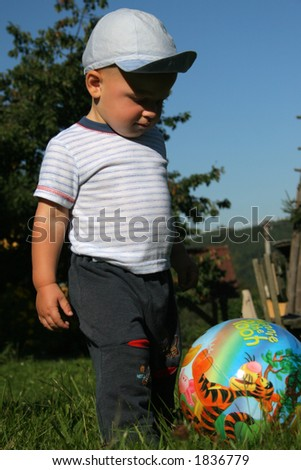 Two-years old boy with a ball.
