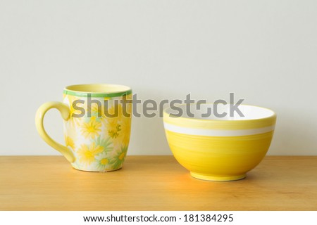 Two yellow mugs on a table