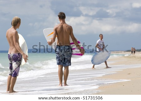 Two yong surfer riding on coastal waves