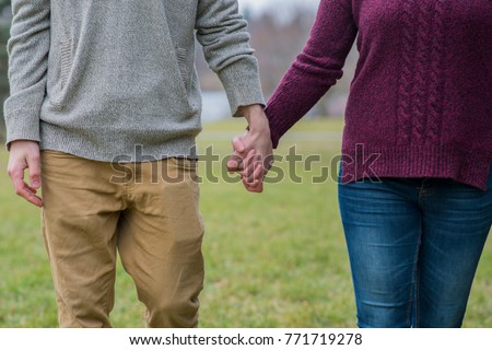 Holding hands while dating