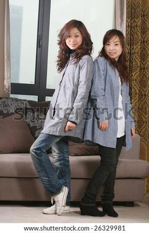 two young asia women at home