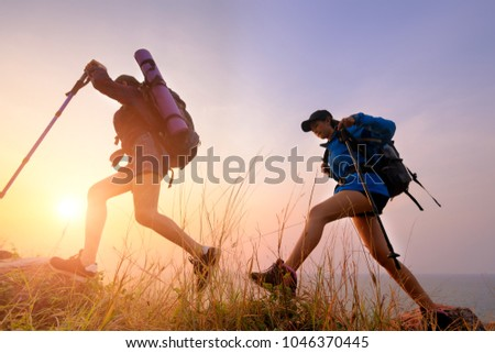 Two young Asian female hipster hiking on mountain holiday, wild adventure. Background for Travel concept  #1046370445