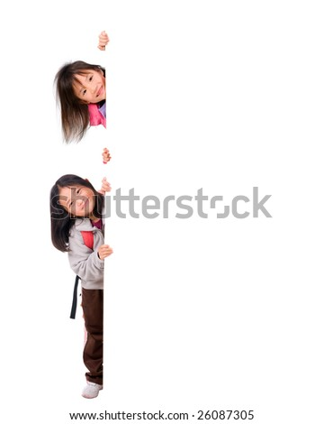 Two young asian girls holding a blank white sign. Put your education message here. - stock photo
