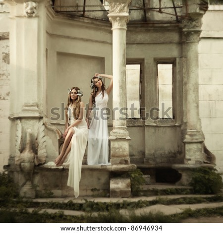 Two young attractive beautiful woman in antique style grain and texturer added