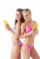 Two young attractive girl with a cocktail on a white background