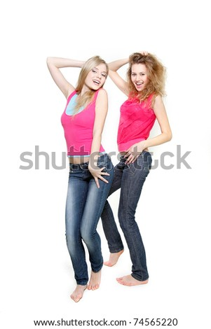 two young attractive women dancing over white