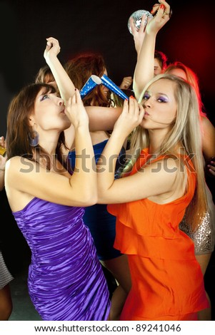 Two young beautiful friends  dancing at a disco. New Year