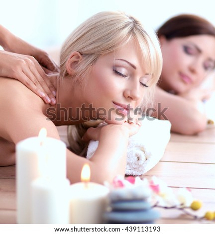 Two young beautiful women relaxing and enjoying at the spa center #439113193