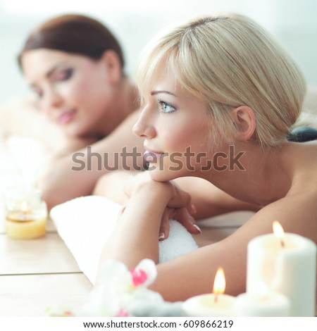 Two young beautiful women relaxing and enjoying at the spa center #609866219