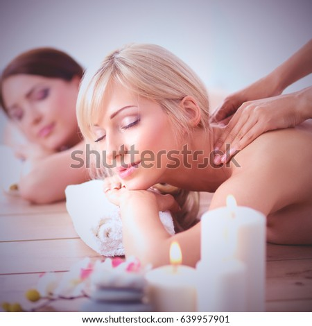 Two young beautiful women relaxing and enjoying at the spa center #639957901