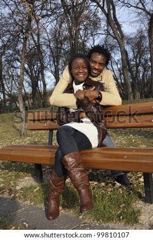 two young black couples at the park