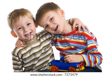 Two young boys cheerfully play