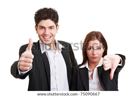 Two young business people holding their thumbs up and down