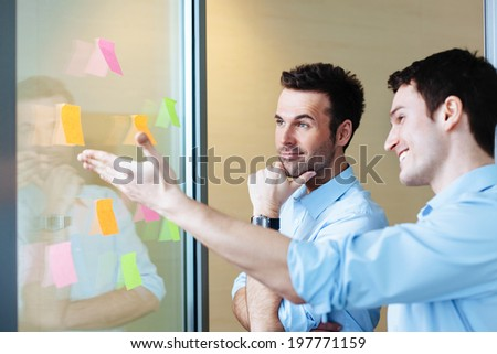 Two young businessmen brainstorming for ideas