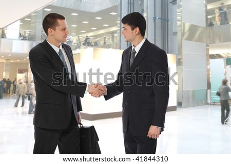 Two young businessmen greet in business center collage