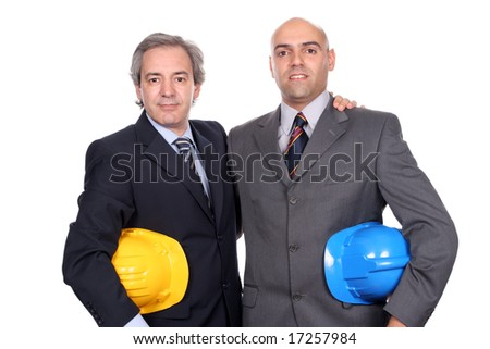 Two young businessmen posing in white background