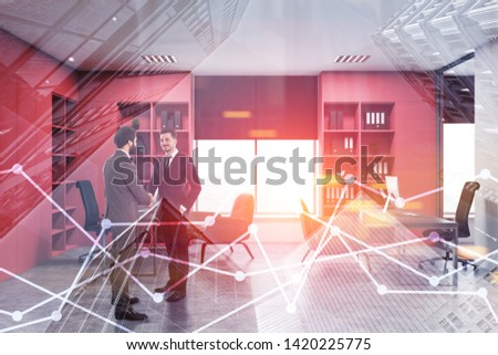 Two young businessmen shaking hands in modern office with white walls, pink bookcases with folders and gray computer desks. Toned image double exposure #1420225775