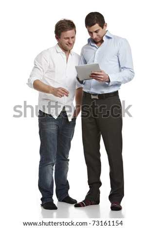 Two young casual men working on tablet pc