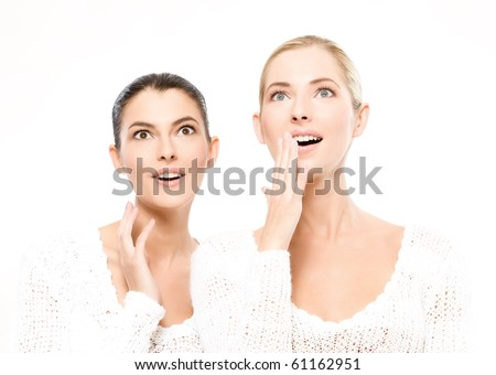 two young caucasian women amazed, isolated on white