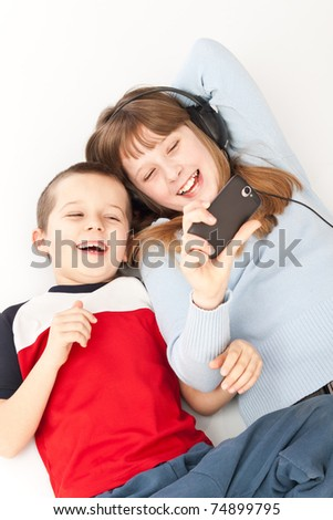 two young children playing on the smart phone
