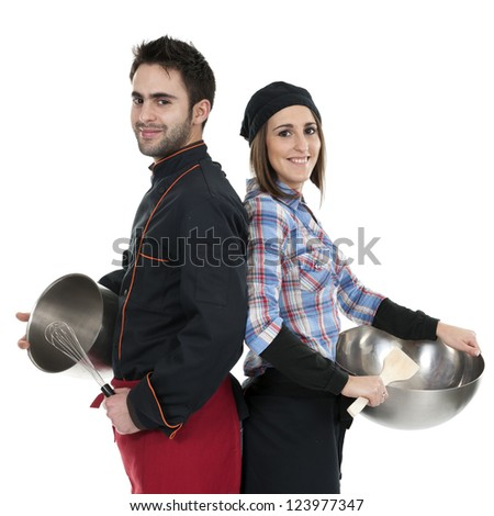 two young cooks , back against each other, isolated on white