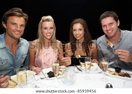 Two young couples in restaurant