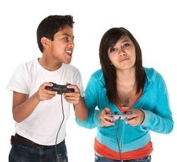 Two young cute Hispanic kids playing video games