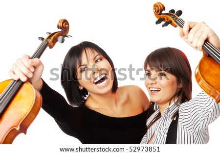Two young excited female graduates  holding up violins