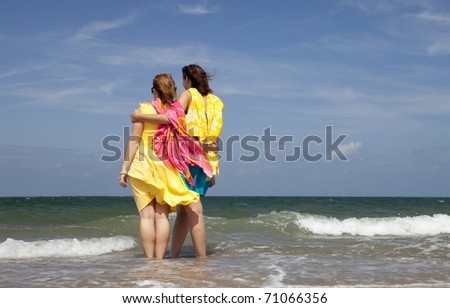 Two young female models having fun at a beach in the South of Holland.