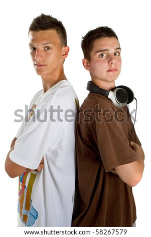 Two young fresh teenagers acting as djs at a party scene. Isolated over white.