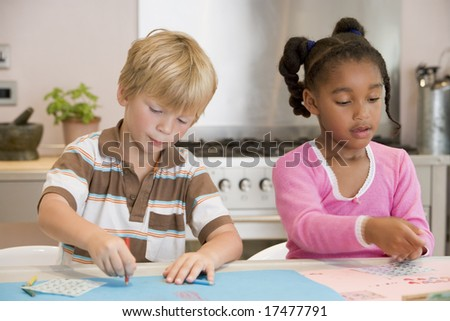 Two Young Friends Drawing Pictures