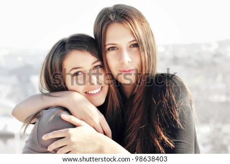 Two young girl friends together on walk