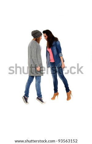 two young girls are fighting each other