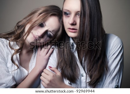 two young girls crying