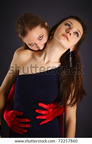 Two young girls portrayed the vampire and his sacrifice on dark background