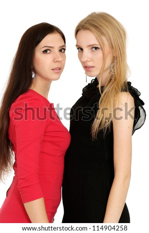 Two young girls posing on white background